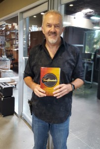 John Suhr with his copy of Tone Wizards